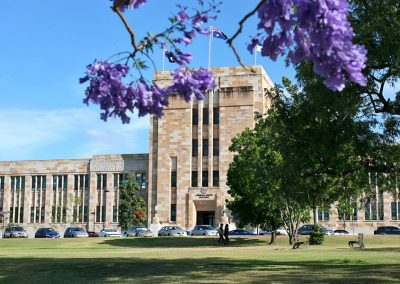 gold-coast-uq-forgan-smith-building-with-flowers